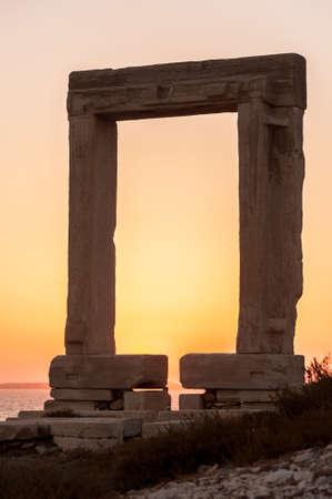 naxos: Portara of Naxos, famous landmark of greece, at sunset