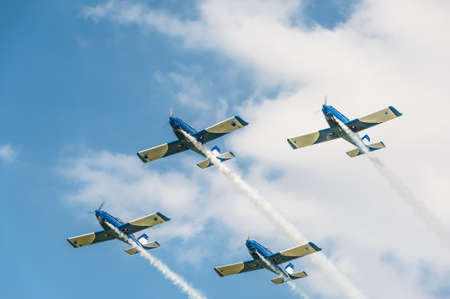 Four airplanes on airshow in formation