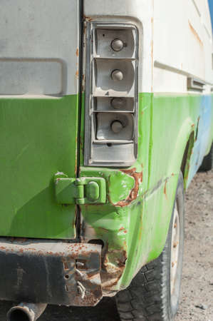 Close up of an old back green accident pickup