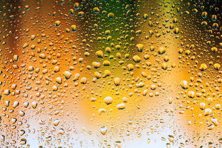 glass texture: Abstract texture - Water drops on glass with yellow and green background