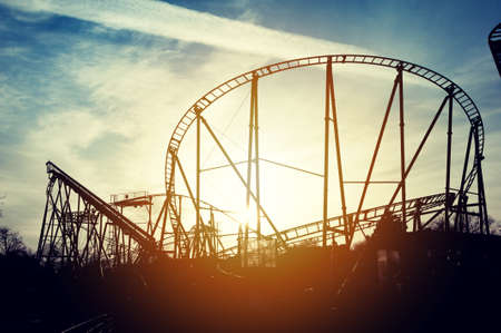 Silhouette of roller coaster in the sunset Stock Photo