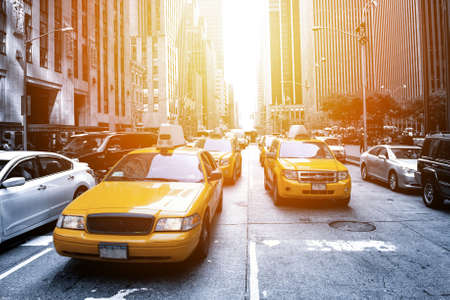 high view: Yellow taxi in a Black and White New York in the sunset Stock Photo