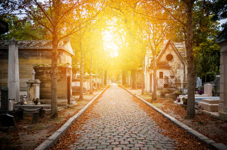 Cemetery in Paris in autumn at sunset Stock Photo