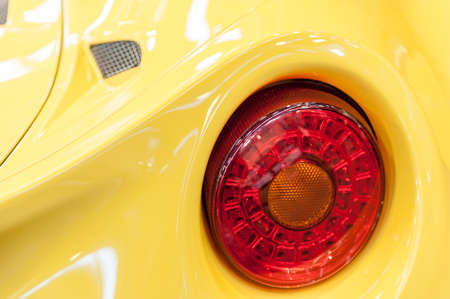 Back of a yellow sport car in the sunlight Stock Photo