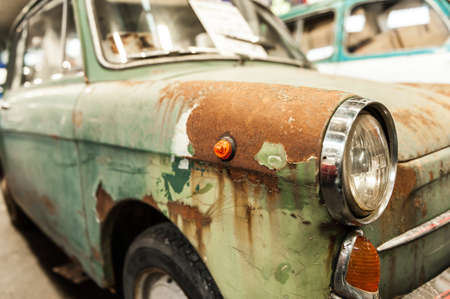Close up on a rusted green old car Stock Photo