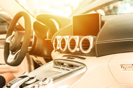 Modern car interior with sunlight in background