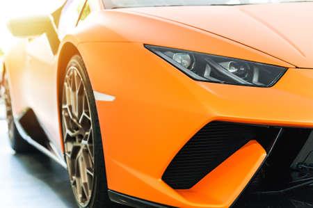Front of an orange sport luxury car in sunset background Stok Fotoğraf