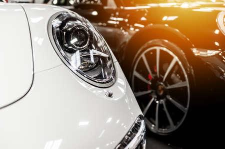 White and black cars in a showroom Foto de archivo