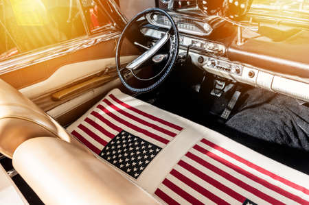 USA flag on seat of a car with sunlight Stock Photo