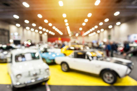 Defocus image of vintage cars in a showroom with sunlight 免版税图像