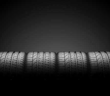 Neumáticos de coche en fila aislado sobre un fondo oscuro, ilustración 3d