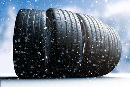 Four car tires rolling on a snow covered road, 3d illustration