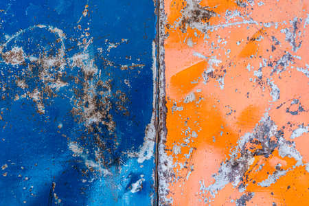 Rusty Colored Metal with cracked paint, grunge background, Blue and Orange Stockfoto
