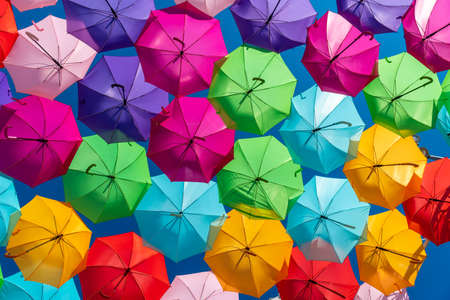 Colorful umbrellas background. Colorful umbrellas in the sky Banco de Imagens