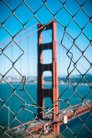 Iconic Golden Gate Bridge through a fence, San Francisco