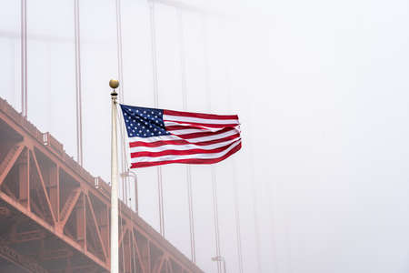 USA flag with Golden Gate Bridge in the fog, San Francisco