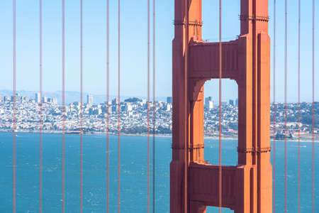 Close up of Golden Gate Bridge with San Francisco skyline