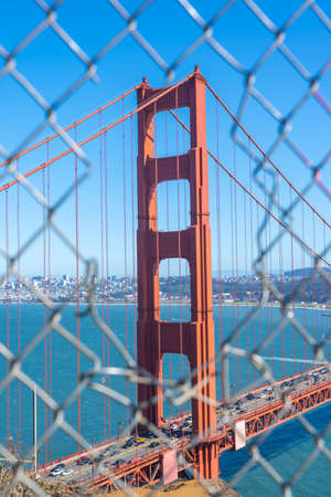 Iconic Golden Gate Bridge through a fence