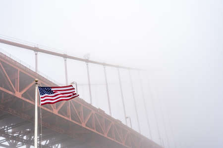 USA flag with Golden Gate Bridge in the fog
