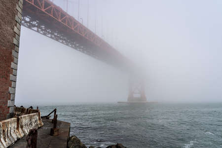 Dramatic view of the Golden Gate Bridge in the fog Banco de Imagens
