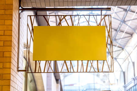 Yellow company sign mockup on a brick wall. 写真素材