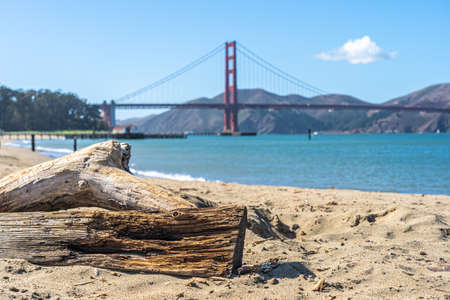 San Francisco beach with The Golden Gate bridge on the horizon. 写真素材