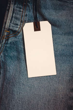 Blue jeans detail with blank tag. 写真素材