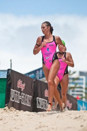 GOLD COAST, SURFERS PARADISE, QLD,  AUSTRALIA - Feb. 2013: C. Falzon (5) A. Richardson (8) compete on the round four of the Surf Ironwoman Series National Championship on February 09th 2013, Gold Coast Australia.