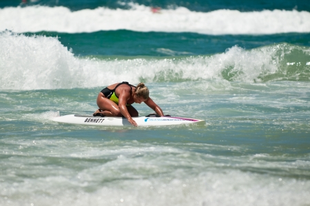GOLD COAST, SURFERS PARADISE, QLD,  AUSTRALIA - Feb. 2013: An athlete  competes in the boarding stage on the round four of the Surf Ironwoman Series National Championship on February 09th 2013, Gold Coast Australia. Editorial