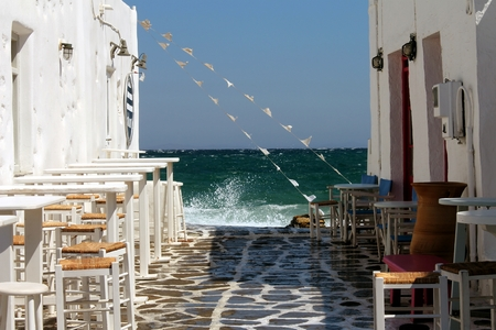 mares: Greek island with rough seas and tavern