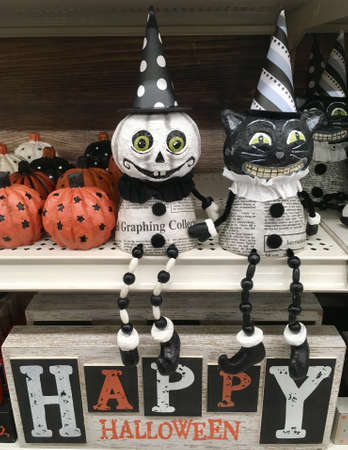 Happy Halloween. Skeleton and cat statues with articulated arms and legs in a shop.