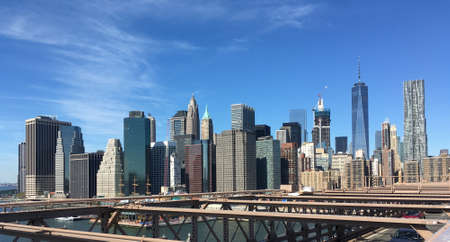 Manhattan skyline from Brooklyn Bridge in a sunny day. New York City, United States