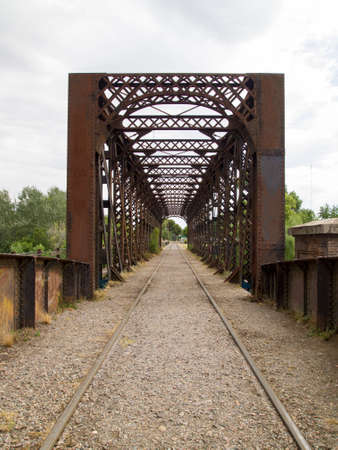 Railway tracks under the bridge. Tandil, Buenos Aires, Argentina. Stock Photo
