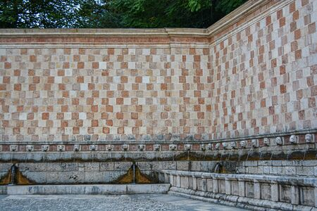 Fountain of the 99 Spouts (Fontana delle 99 cannelle), Historic fountain with 99 jets distribuited along three walls, L Aquila, Italy