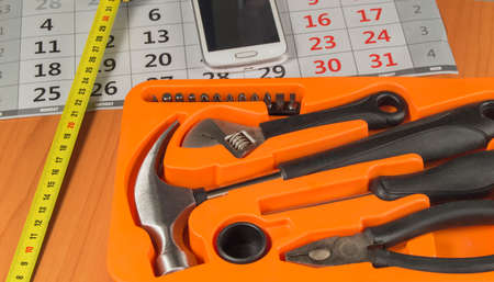 flatnose: a set of tools and a mobile phone on the calendar