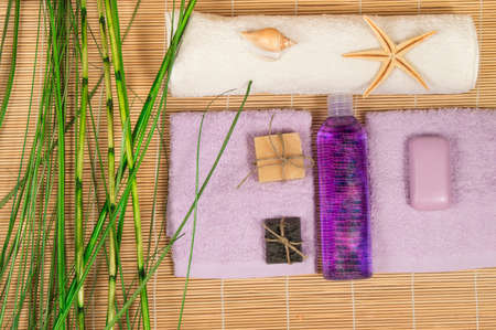 natural soap: Spa and Wellness setting with natural soap, stones towel Bamboo. Stock Photo