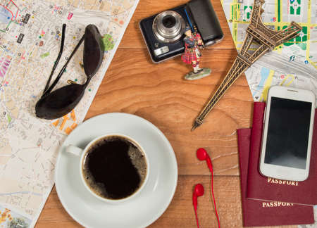 beefeater: Prepare for travel, documents, maps coffee sunglasses Souvenirs camera. Stock Photo