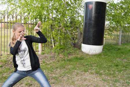 threatens: angry young girl threatens to nail Boxing in the Park.
