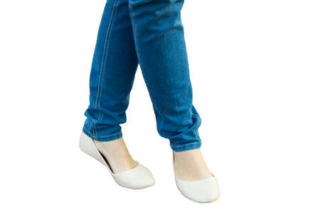 summer shoes: The girl stands, feet in jeans and summer shoes, isolated. Stock Photo