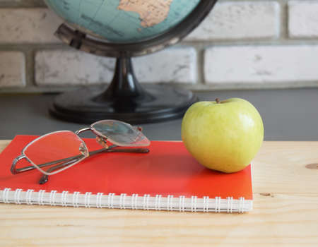 World teachers  Day in school. Still life with books, globe, Apple, glasses selective focus.