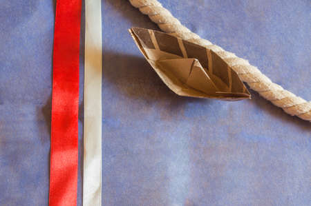 paper boat: USA holiday, happy Columbus day paper boat on blue background and ribbons decorations