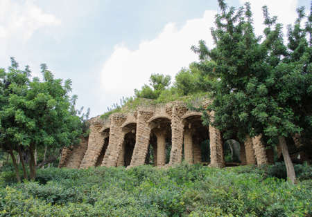 colonnaded: Columns in Park Guell designed by Antoni Gaudi in Barcelona Spain.