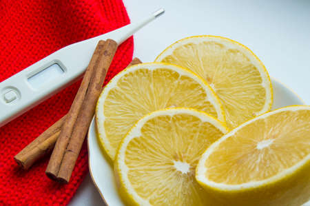 snotty: The concept of treating colds - lemon, cinnamon, thermometer scarf