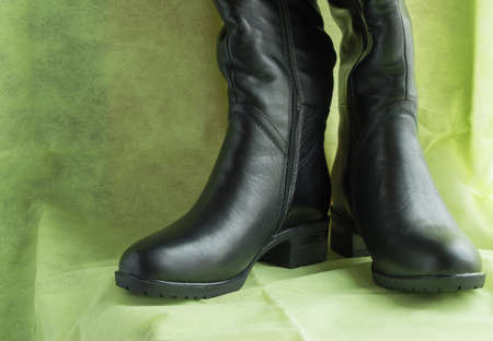 Pair of womens fashion black leather boots