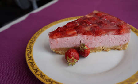 jello: A piece of delicious strawberry cake with jello and strawberries lying on a beautiful plate, top view