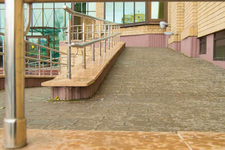 Ramp way for the movement of wheelchair users at the entrance to the building. Stock Photo