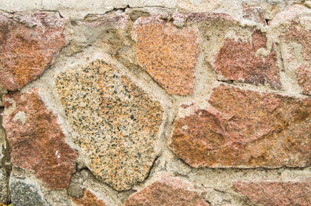 background stone walls of pink granite, texture Фото со стока