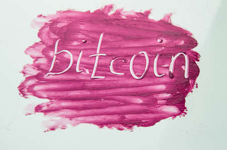 Cryptocurrency Bitcoin symbol on textured background red lipstick
