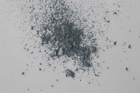 Blue or gray eye shadows, scattered crumbs on white background 写真素材