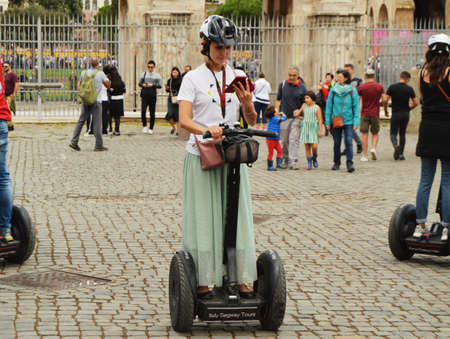 Rome, Italy-October 07, 2018, girl guide Segway City tour on Segway near Colosseum